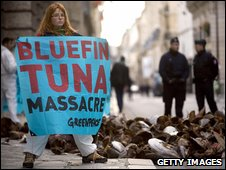 Protester with dumped tuna parts