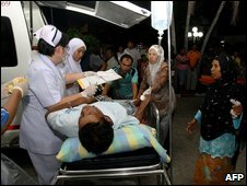 An injured man outside a hospital in the Cho-i-Rong distrist of Narathiwat, Thailand