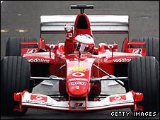 Rubens Barrichello celebrates as he
