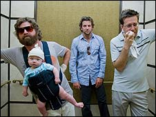 Zach Galifianakis (with baby), Bradley Cooper and Ed Helms in The Hangover