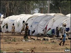 Tamil civilians walk near their tents at the Manik Farm refugee camp, Vavuniya - May 27 09