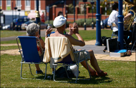 Mark Jones sent us this shot of a couple soaking up the sun and listening to a band play at Barry Island.