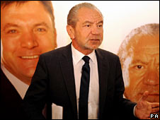 Alan Sugar, against a large photo of Schools Secretary Ed Balls and himself