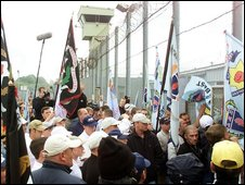 Loyalists gather outside the Maze prison as members of the Ulster Freedom Fighters are released from the Maze Prison in July 2000