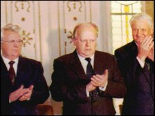 File photo from 1991 of Leonid Kravchuk, Stanislav Shushkevich and Boris Yeltsin applauding after creating the Commonwealth of Independent States