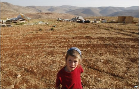 A Jewish boy is seen at the West Bank outpost of Maoz Esther, near Ramallah, 9 June