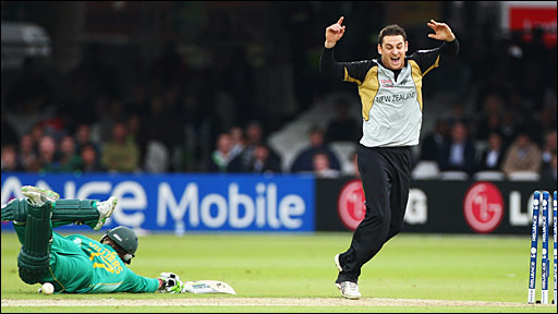 Nathan McCullum (right) celebrates the run out of AB de Villiers