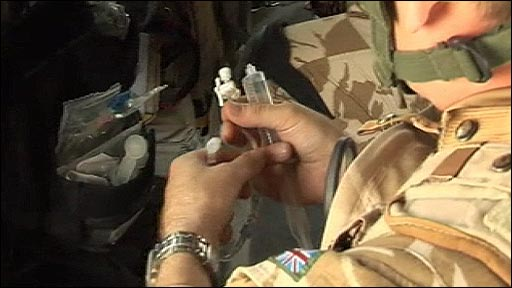 Soldier with medical kit