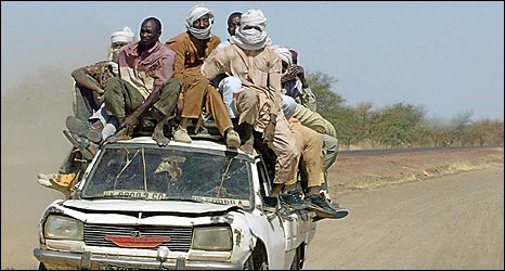 People pile onto a car in Chad