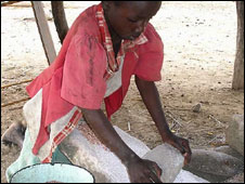 An orphan preparing maize