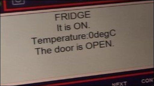 The intelligent kitchen computer system alert. Message reads: Fridge is on.Temperature 0degc. The door is open