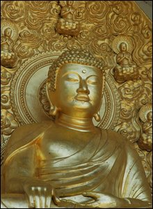 One of four gilded statues of Buddha