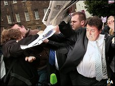 Nick Griffin facing protesters in London