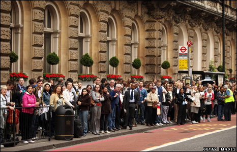 Commuters queue for buses outside Victoria Station