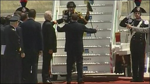 Col Gaddafi arrives in Italy