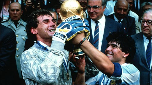 Argentina goalkeeper Nery Pumpido and captain Diego Maradona lift the World Cup
