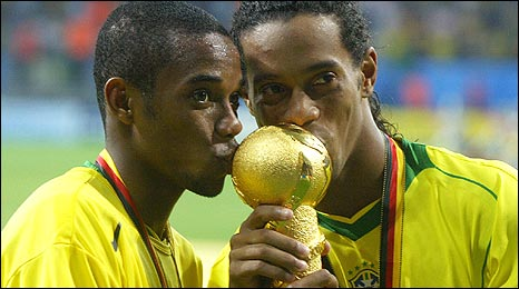 Robinho (left) and Ronaldinho celebrate in 2005