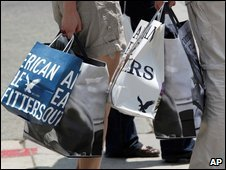 Shoppers hold bags in Santa Monica, California