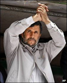 Iranian President Mahmoud Ahmadinejad gestures to thousands of supporters  at a rally in Tehran