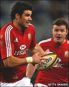 Mike Phillips sets off on a run with Brian O'Driscoll in support