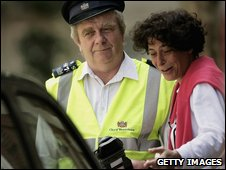 A driver argues with a traffic warden
