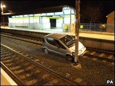 Car on railway tracks