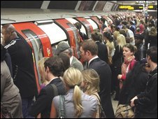 Commuters trying to board a Tube train at Clapham Common station