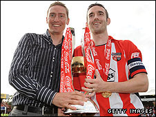 O'Connor (right) and manager Andy Scott with the League Two championship trophy