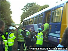 Passengers being helped from train