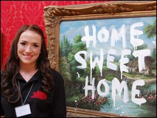 Jade Pearson standing in front a Banksy painting