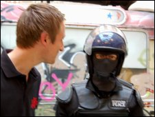 Tom Scott looking at a Banksy