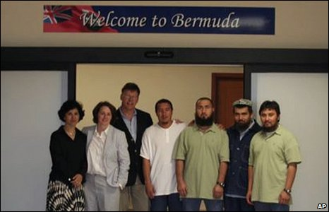 In a photo released by a lawyer for the detainees on Friday, the four Guantanamo Bay ethnic Uighur detainees (right) are shown accompanied by unidentified people upon their arrival in Hamilton, Bermuda, on Thursday