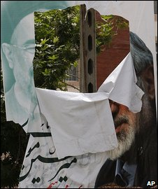 A torn poster for Mir Hossein Mousavi in Tehran