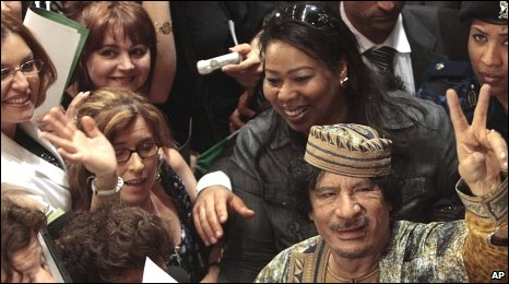 Col Gaddafi at the end of a meeting with prominent Italian women
