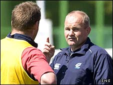 Andy Robinson gives instructions at training