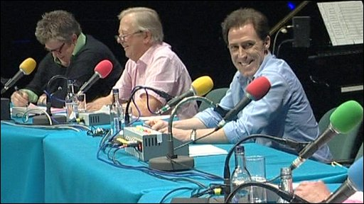 Panelists sitting at microphones for 'Sorry i Haven't a Clue' recording
