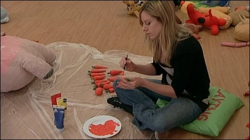 Woman painting object