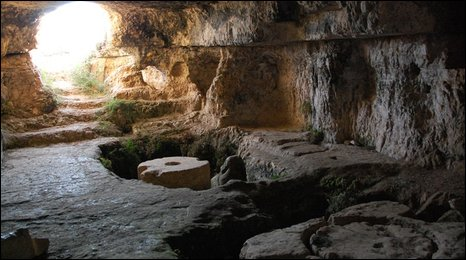 An ancient wine press in a cave in the West Bank