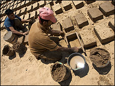 Men make mud bricks, Gaza