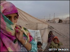 People in a camp for displaced people near Peshawar, Pakistan, 15 June 2009