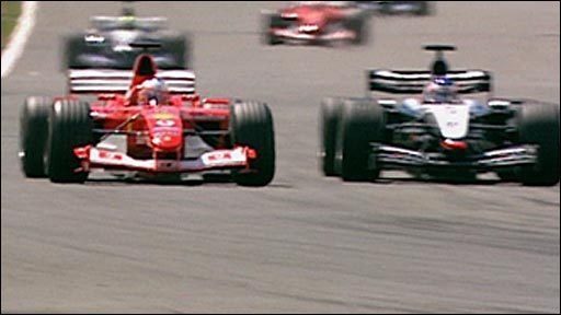 Rubens Barrichello battles for the lead of the 2003 British Grand Prix