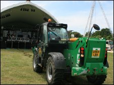 Tractor setting up main stage