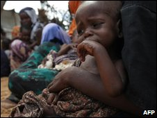 Newly-displaced families from ongoing fighting in Mogadishu at a refugee camp, on 15 May 2009