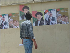 Afghan man looks at presidential campaign posters