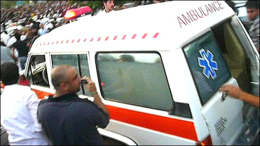 Ambulance takes away woman