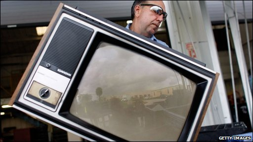 Analogue TV being thrown away