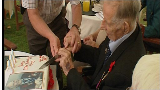 Harry Patch cuts his 111th birthday cake