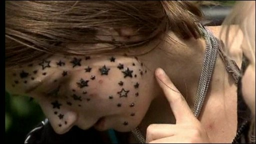 a tattoo artist after she left his parlour with 56 stars on her face