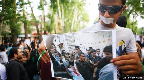 holds a pA supporter of defeated Iranian presidential candidate Mir Hossein Mousavi holds up a picture during protests June 16, 2009
