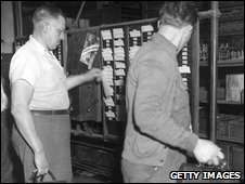 Workers clocking off in 1944